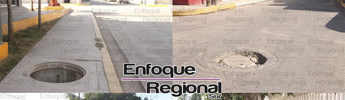Problemas de vialidad por alcantarillas dañadas y por  residuos de poda de árboles  en calle La Paz.